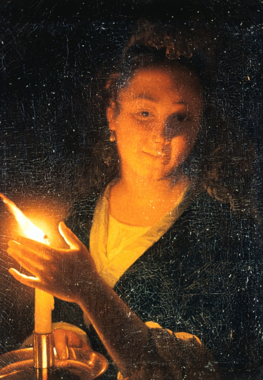 photo of woman with candlethetic magic